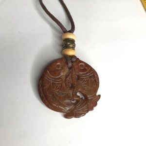 Necklace Carved Stone Fish on leather brown beads